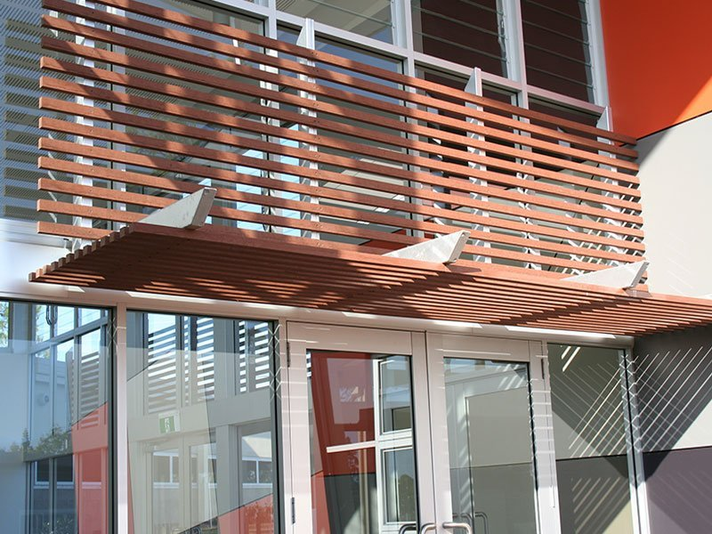 Wood plastic composite screening as an architectural feature at a new school