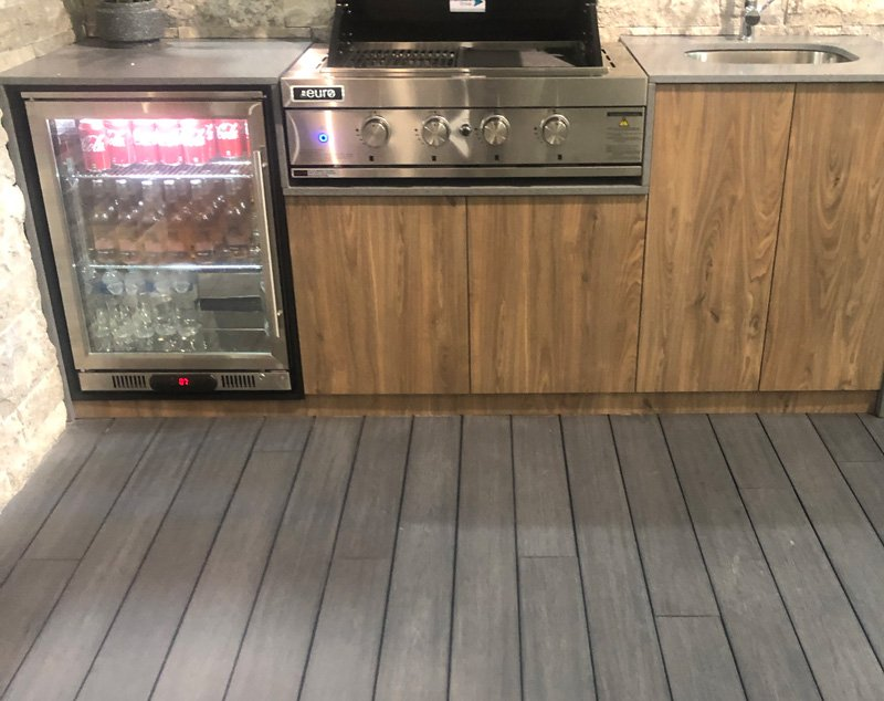 Our LOKI composite decking complementing the outdoor kitchen area.